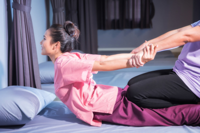 Thai massage by stretch back and hands