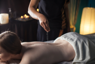 Relaxing woman in wellness beauty spa having aroma therapy massage